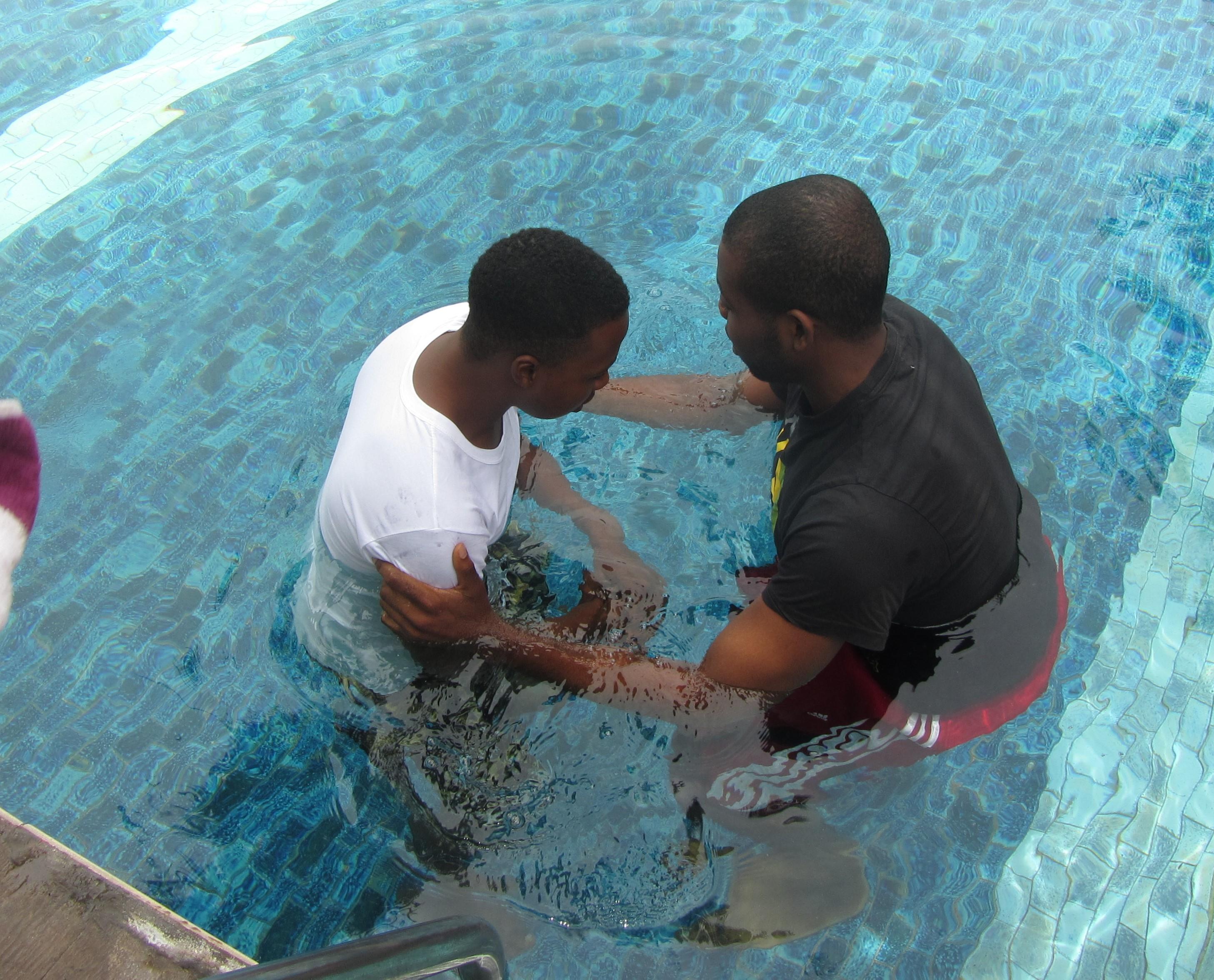 Charles Baptizes Tope