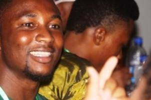 Simon Ajayi smiles